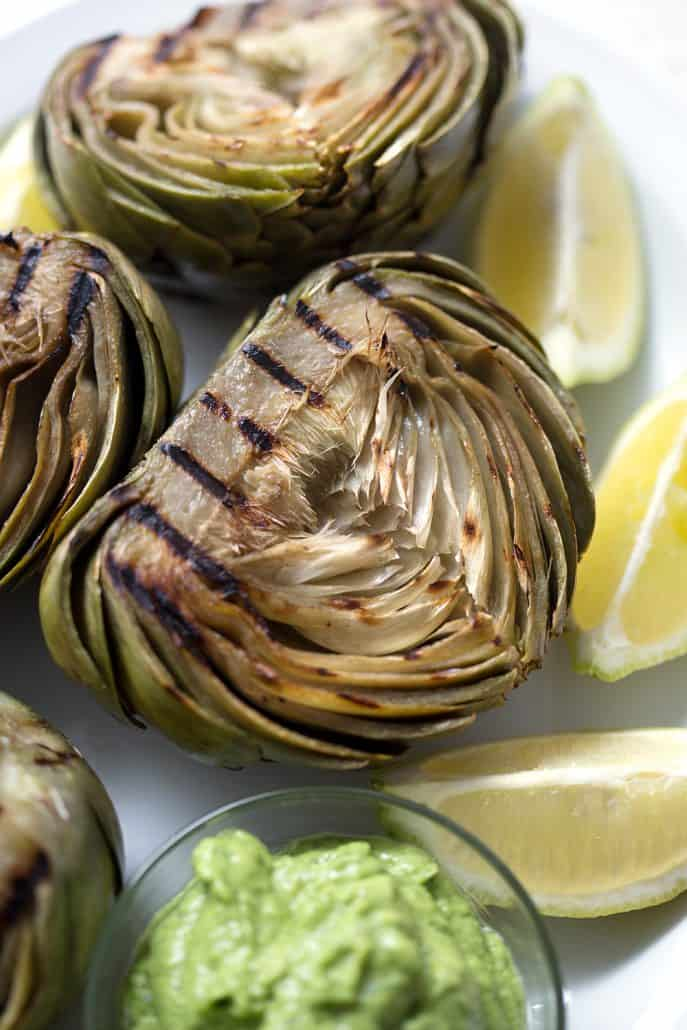 grilled artichokes with lemon wedges