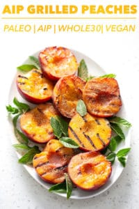 grilled peaches on platter with mint garnish and text