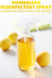 spray bottle on white background surrounded by lemons