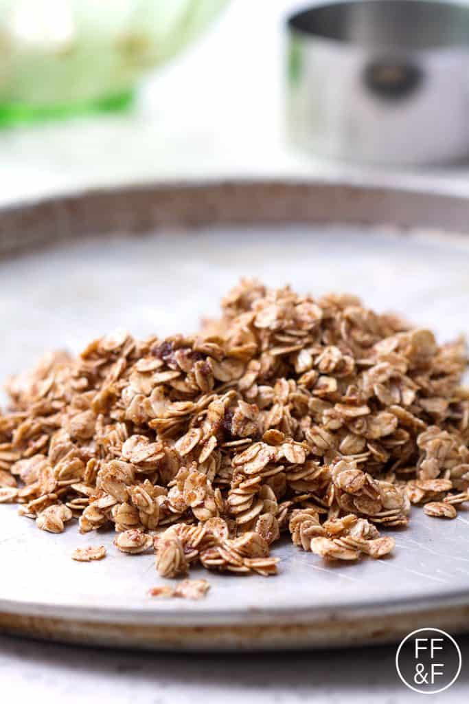 Nut Free Granola that's delicious for breakfast on it's own or to be used in granola bars or sprinkled over a smoothie. This recipe is allergy friendly (gluten, dairy, shellfish, nut, egg, and soy free) with vegan options.