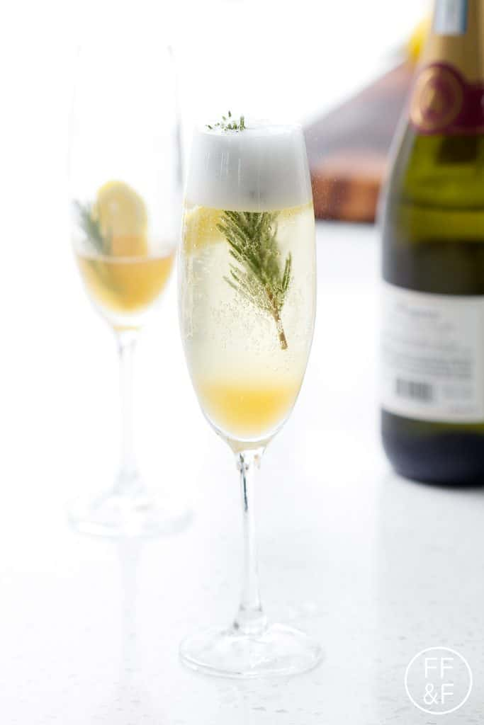 Sparkling Lemon Rosemary Cocktail with Four Roses Bourbon and Prosecco from Foodfashionandfun.com