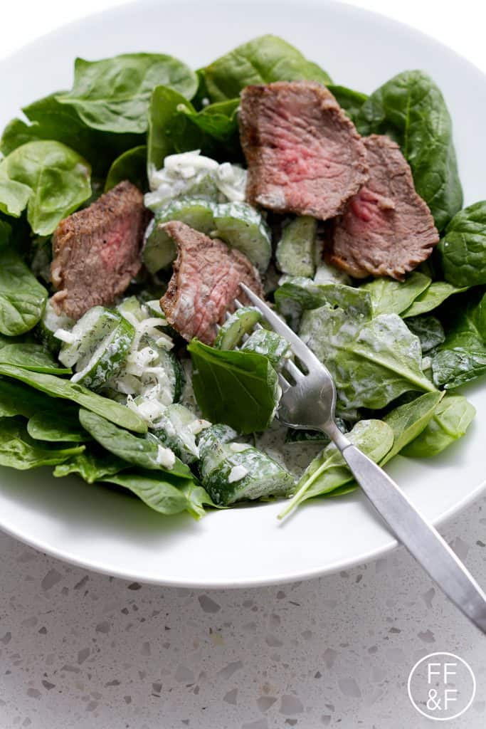 This Tri Tip Spinach Salad with a Creamy Cucumber Dill Dressing recipe can be used with cold, leftover tri tip or hot, right off the grill. You can also make the dressing up to a day in advance so all you need to do is assemble for dinner. Either way, it's delicious. This recipe is allergy friendly (gluten, dairy, shellfish, nut, egg, and soy free) and suits the autoimmune protocol and paleo diets.