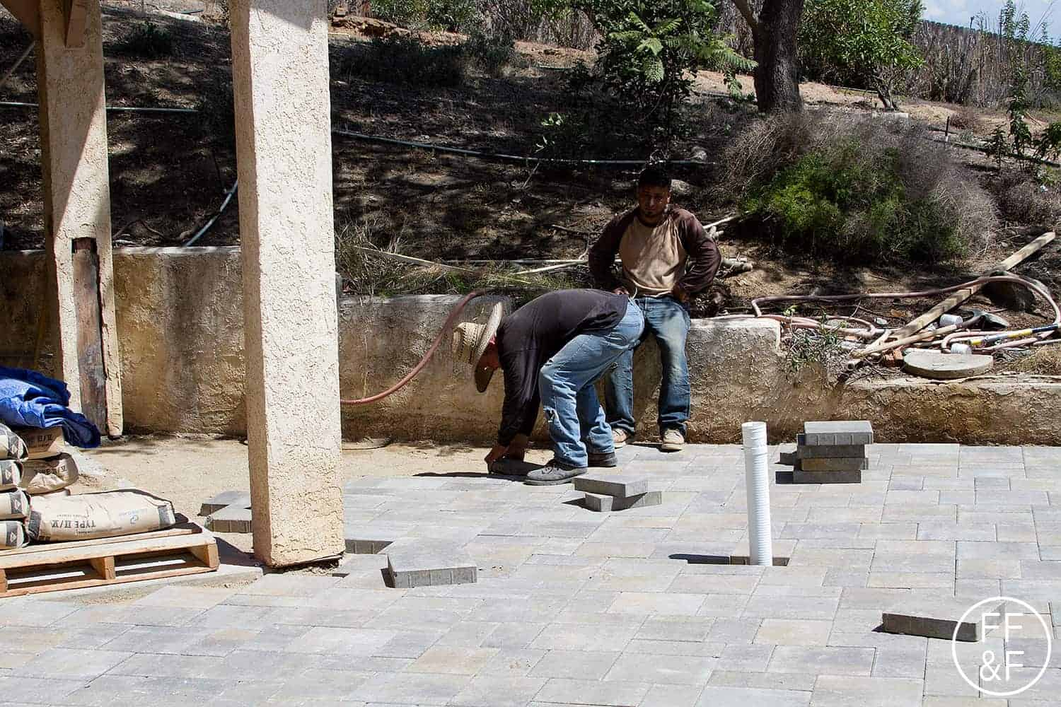Placing the pavers to extend the entertaining space in the backyard. #bethhomeproject