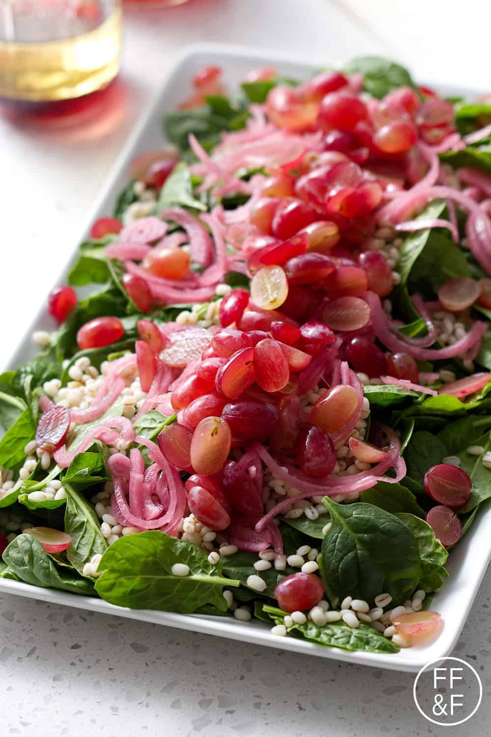 Spinach Salad with Barley with Grapes and Pickled Onions