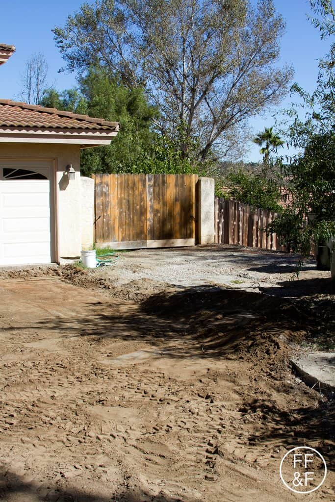 View during front yard renovations, of the future driveway and entrance to the side yard.