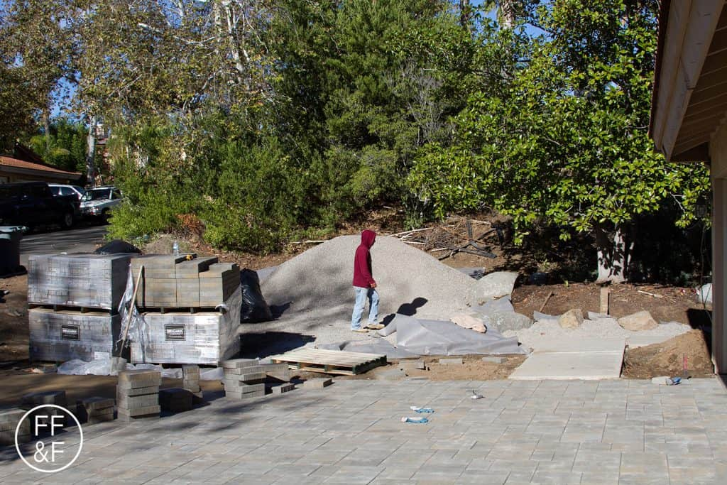 Installing pavers for the driveway during front yard renovation.
