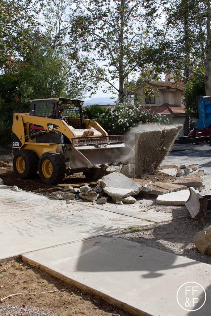 Demo of driveway during front yard renovation.