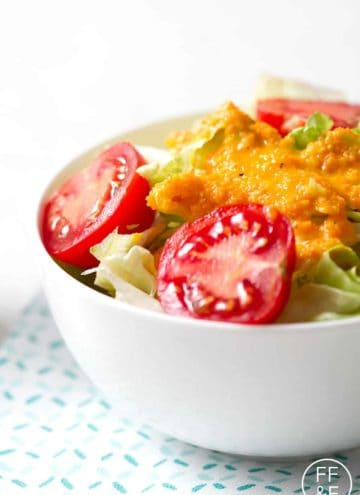 carrot ginger salad dressing on bowl of salad