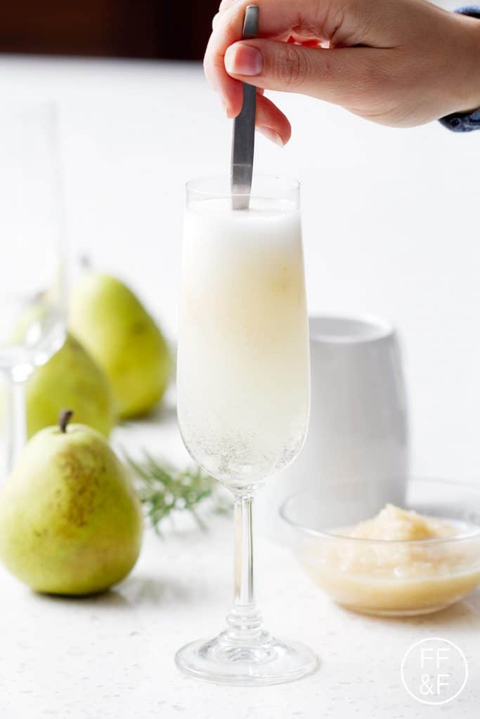 A Rosemary Pear Sparkler is a savory sweet mix of fresh herbs and sweet pears topped with sparkling wine or champagne.