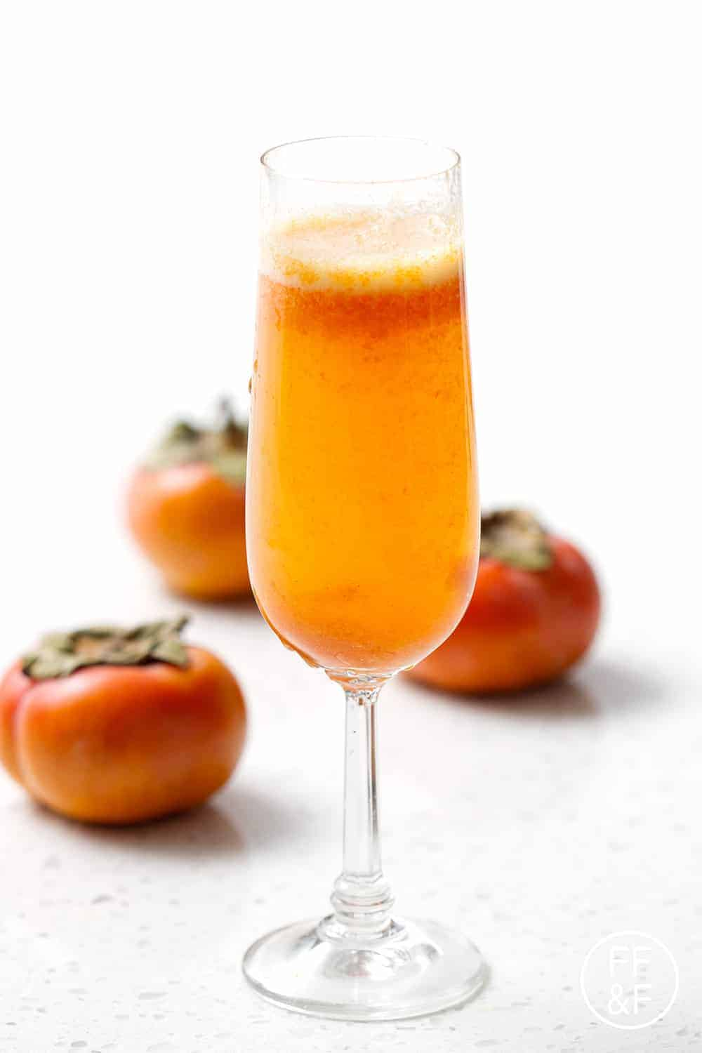Spiced Persimmon Sparkler is a cinnamony champagne cocktail with a fruity persimmon puree.