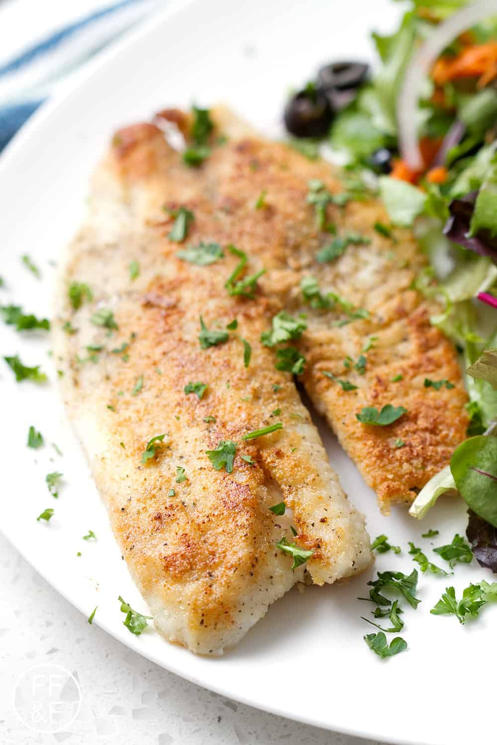 Here's an easy recipe for Pan Fried Tilapia that's quick and full of flavor. Perfect for a weeknight meal when you need dinner on the table, fast! This recipe is perfect if you're on a gluten free, dairy free or autoimmune protocol (AIP) diet.
