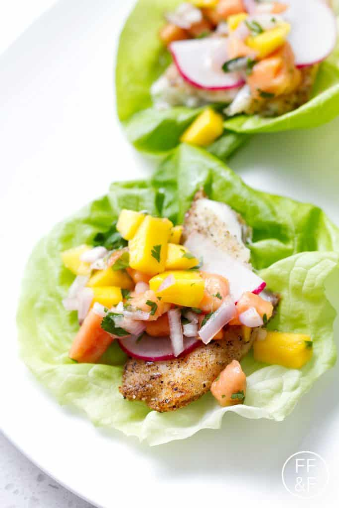 Tilapia Lettuce Wraps with Mango Papaya Salsa are a fresh and healthy dinner that requires very little cooking. This recipe is great for gluten free, dairy free and autoimmune protocol (AIP) diet.