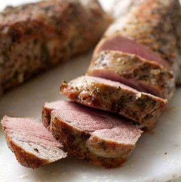 slices of AIP Pork Tenderloin on cutting board