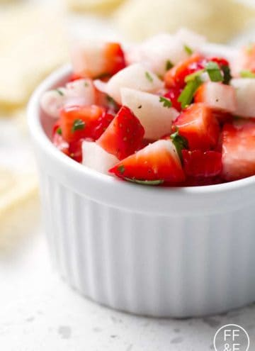 This is a nightshade free Strawberry Salsa recipe for a naturally sweet and tangy topping or dip. This recipe is allergy friendly (gluten, dairy, shellfish, nut, egg, and soy free) and suits the autoimmune protocol (AIP), paleo and vegan diets.