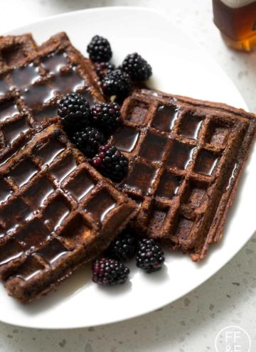 plate of plantain waffles with blackberries