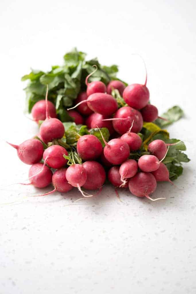 Fresh radishes ready for roasting.