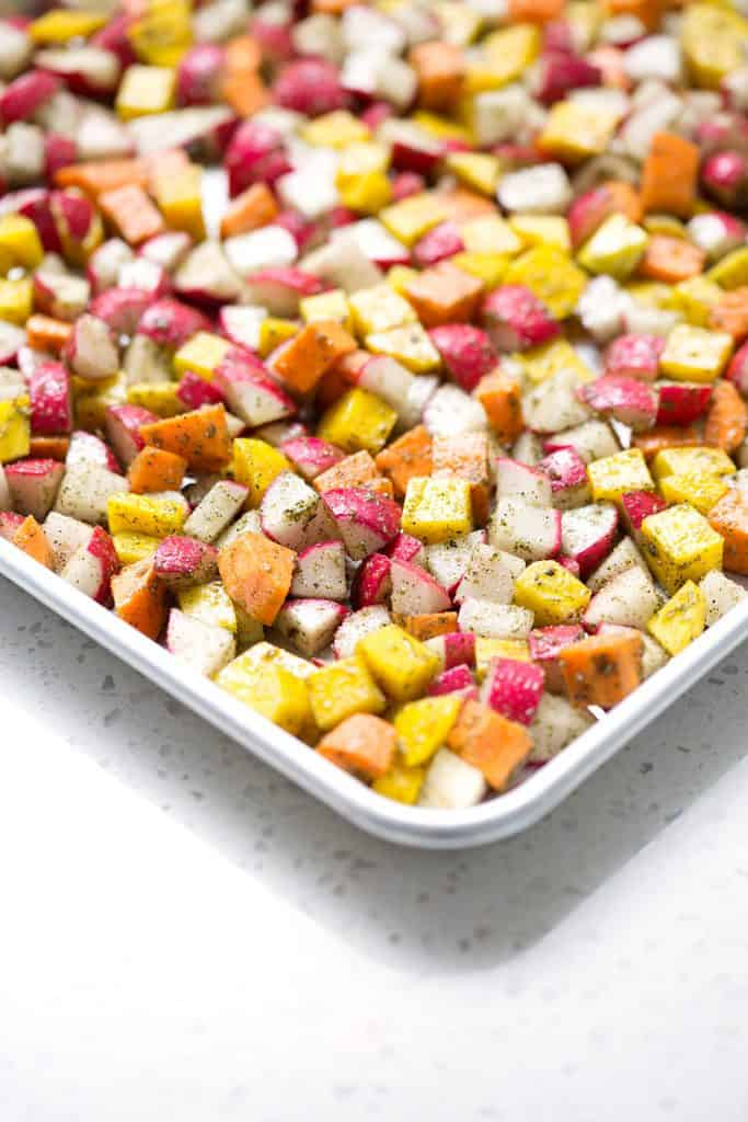 This recipe for Roasted Root Vegetables uses radishes, sweet potatoes and beets with just a few other ingredients to make a colorful and hearty veggie side dish. It's time to make this dish an AIP veggie go-to for healthy, delicious and easy meals. This recipe is allergy friendly (gluten, dairy, shellfish, nut, egg, and soy free) and suits the autoimmune protocol (AIP) and paleo diets.