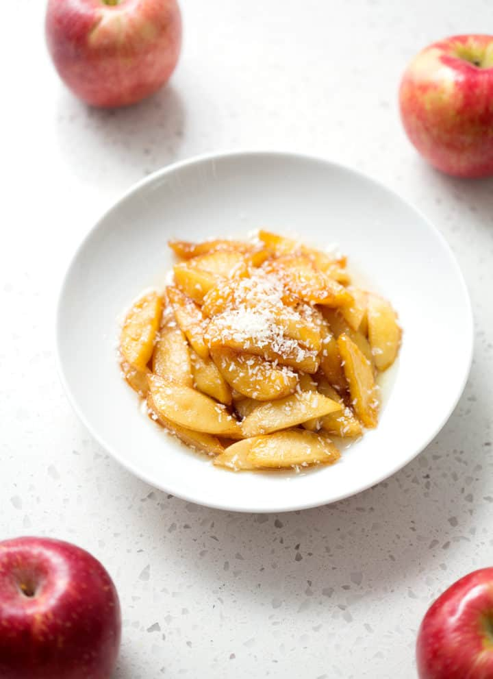 plate of caramelized apples surrounded by apples