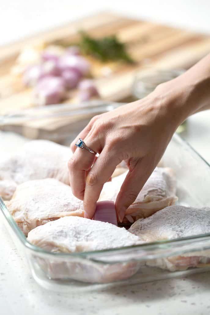 placing chicken in roasting pan