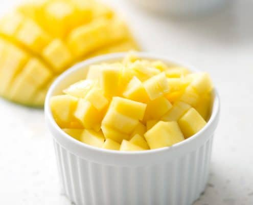 chopped mango over 'sticky rice' in ramekin