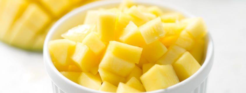 chopped mango over 'sticky rice' in ramekin