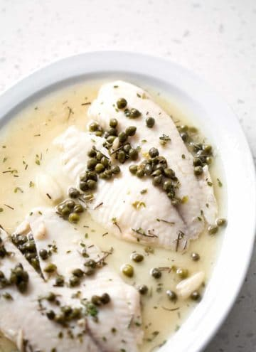 fish fillets on serving platter with capers and sauce