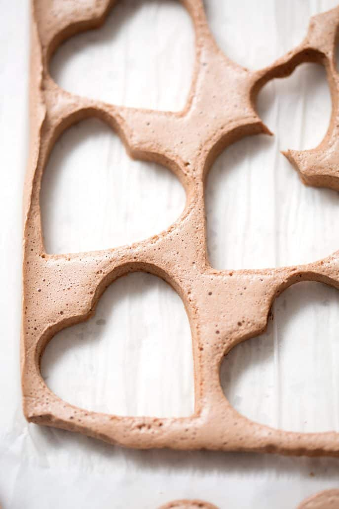 heart shaped chocolate marshmallows on white parchment paper