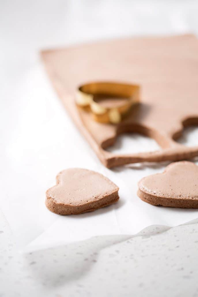 heart shaped cookie cutter cutting chocolate marshmallows