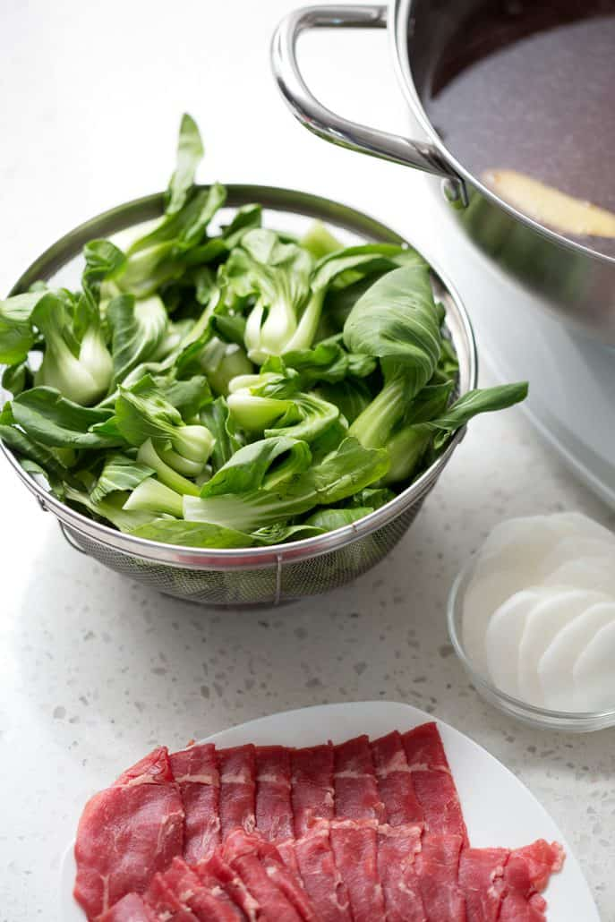 bok choy with hot pot pan in background