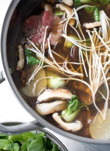 mushrooms, bok choy and meat in bone broth