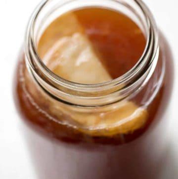 SCOBY in jar of homemade kombucha tea
