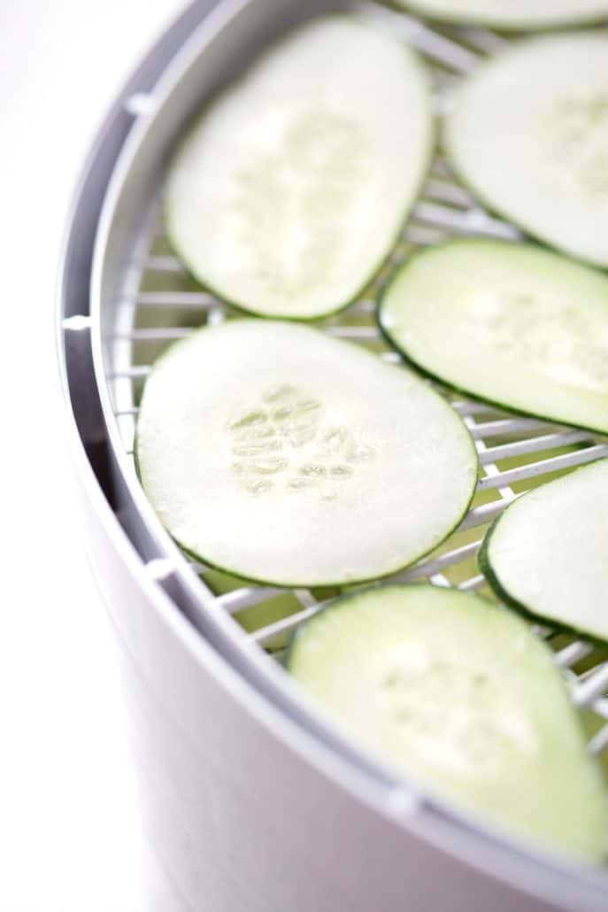 sliced cucumber is dehydrator tray