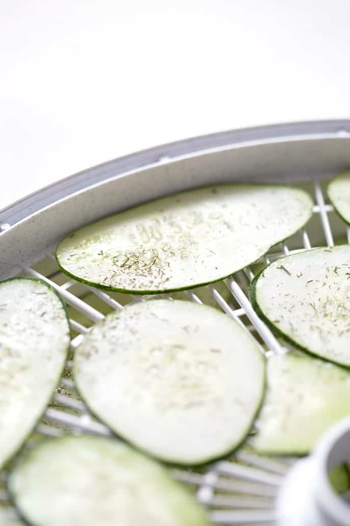 seasoned cucumbers in dehydrator tray