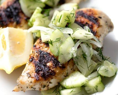 Grilled Chicken and Cucumber Dill Salad on white background