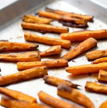 crispy sweet potato fries on baking sheet