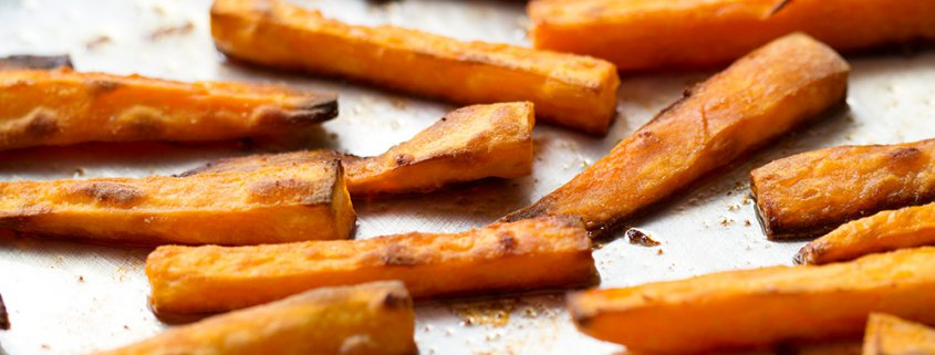 crispy sweet potato fries on baking sheet