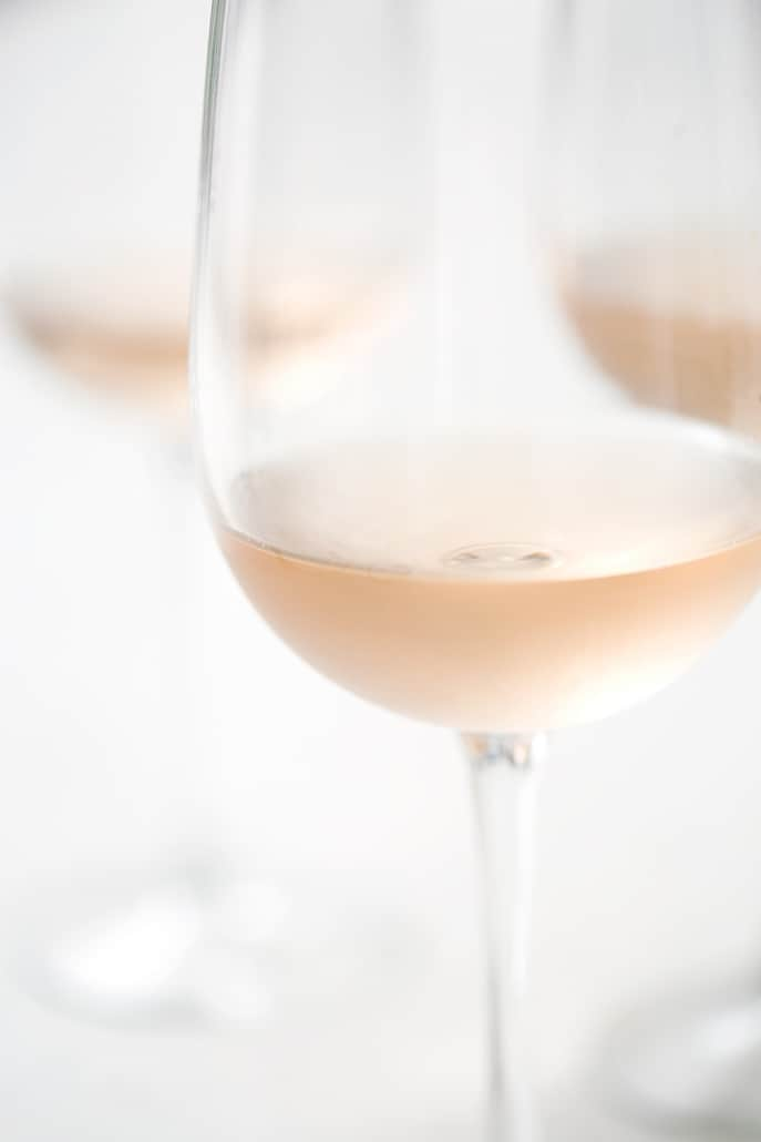 close up of rose filled wine glass