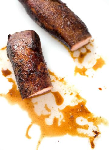 pork loin and sauce on white background