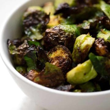 This AIP Air Fryer Brussel Sprouts recipe can be made in under 30 minutes and is the easiest way to cook brussel sprouts that are crispy and delicious. This recipe suits the Autoimmune Protocol (AIP), Paleo, and Vegan diets.