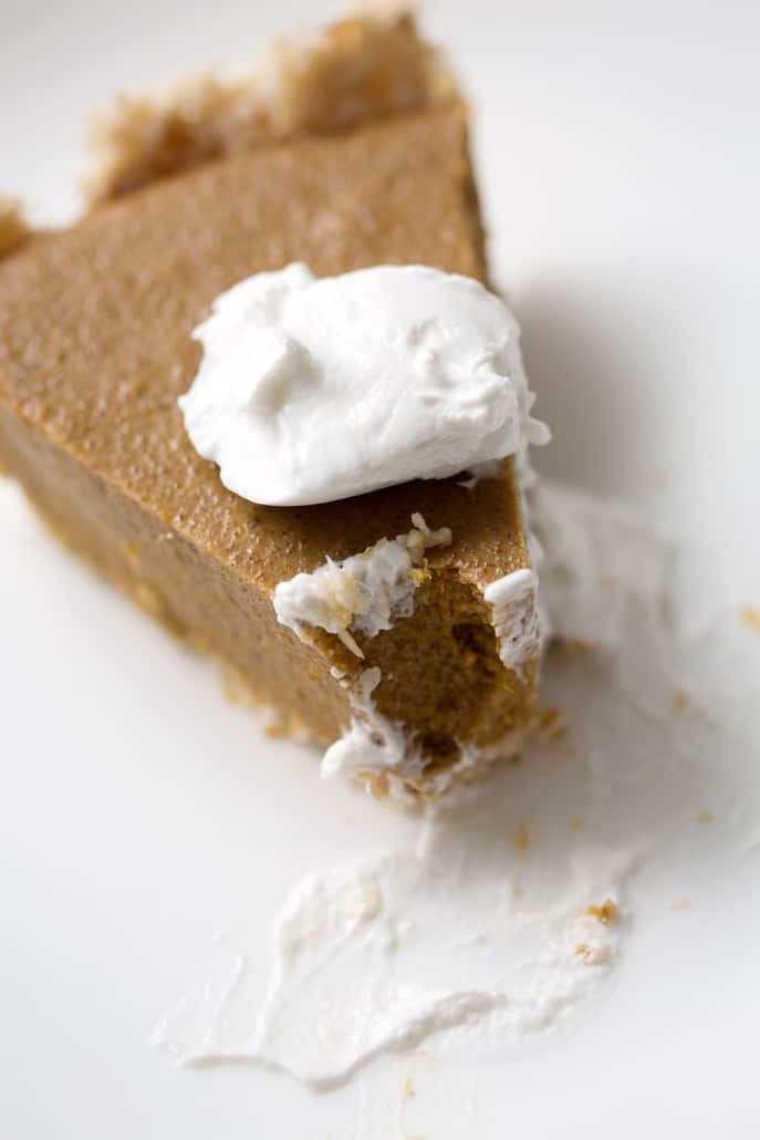 piece of pumpkin pie with dollap of cream