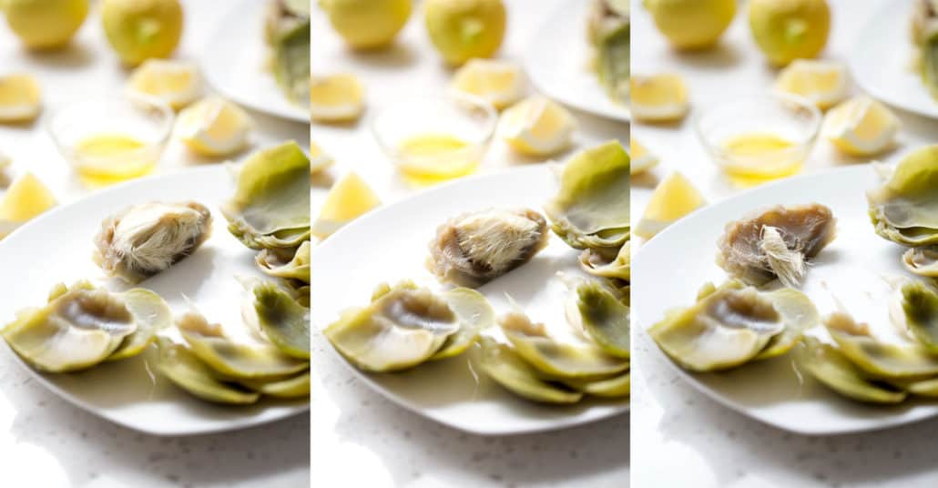 artichoke hearts with and without hair on a white plate