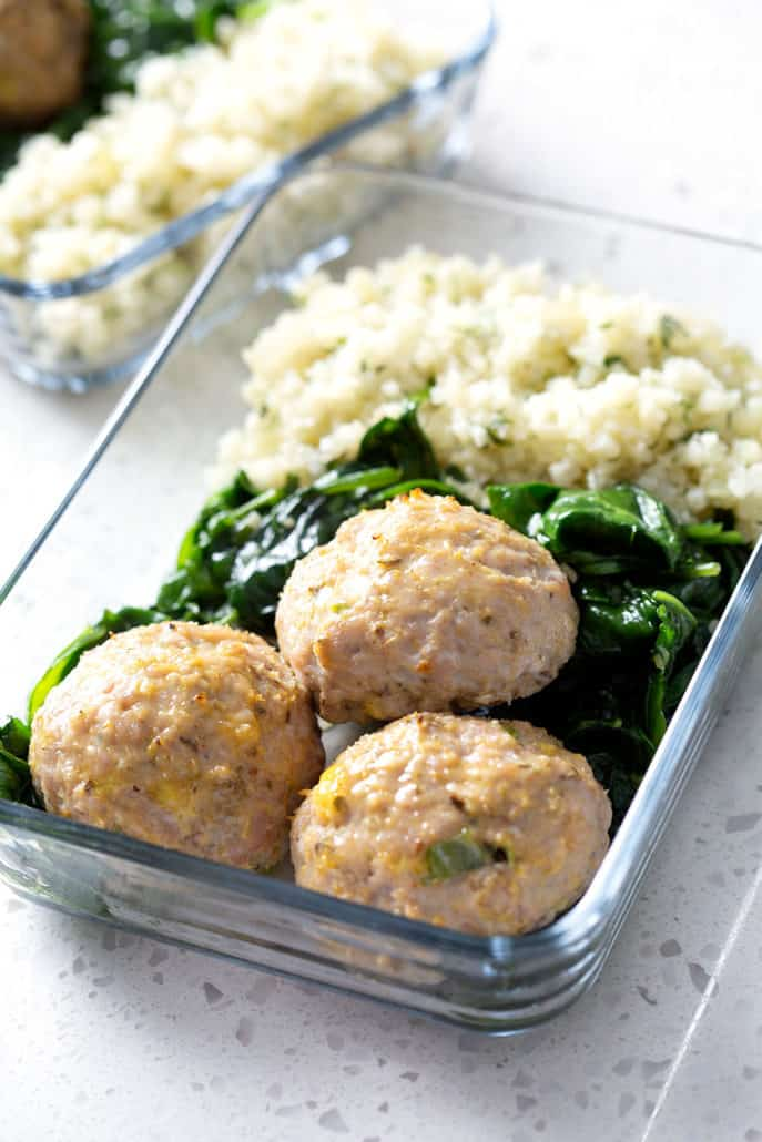 meatballs, spinach and rice in glass dish