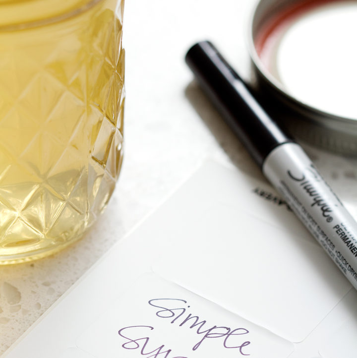 mason jar next to label and sharpie