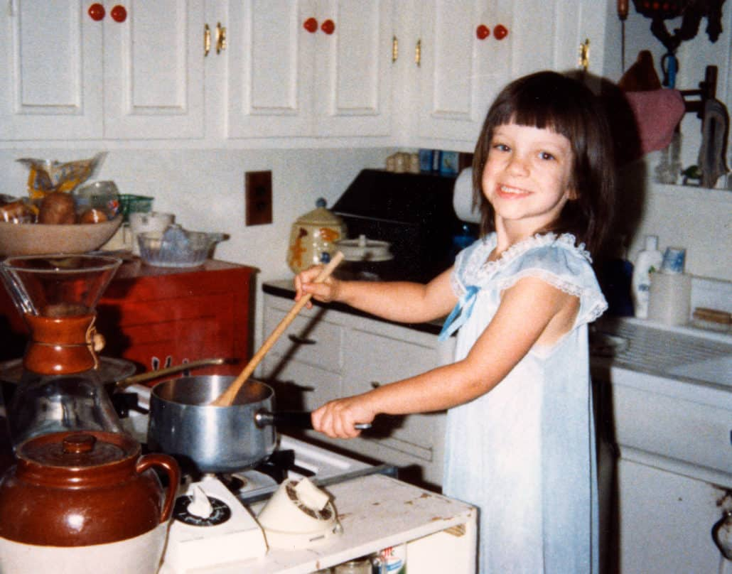child cooking in kitchen circa 1985