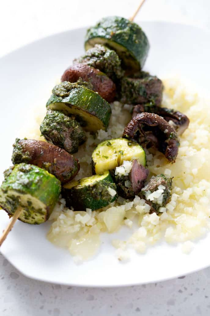 grilled meat skewer on plate with vegetables and cauliflower rice