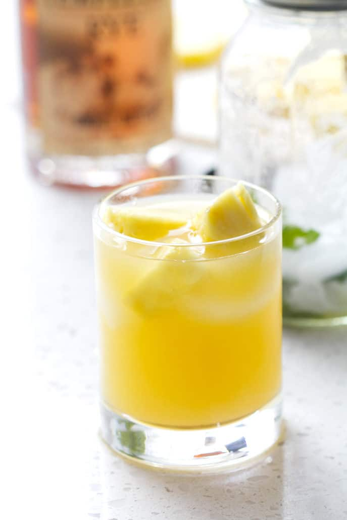 cocktail glass with pineapple chunks