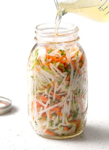 shredded vegetables in large mason jar