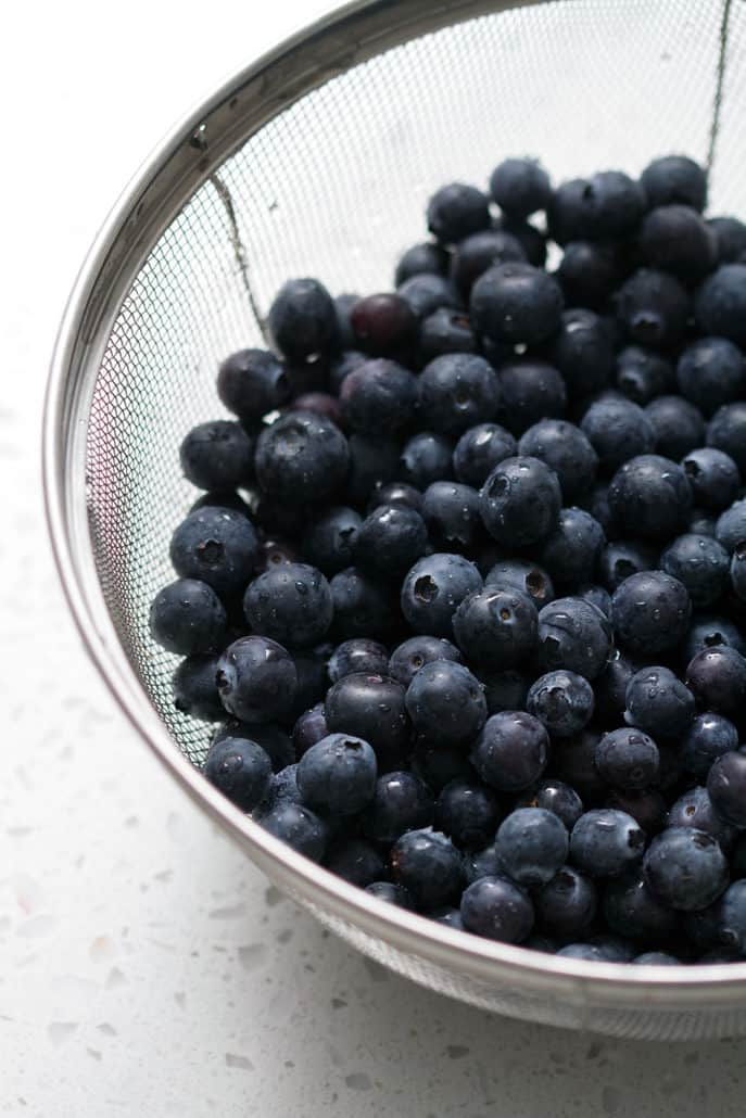blueberries in wire mesh strainer
