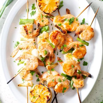 grilled shrimp skewers on platter