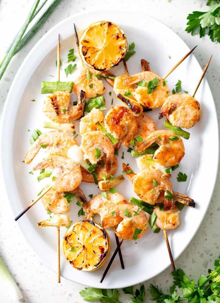 grilled shrimp skewers on platter